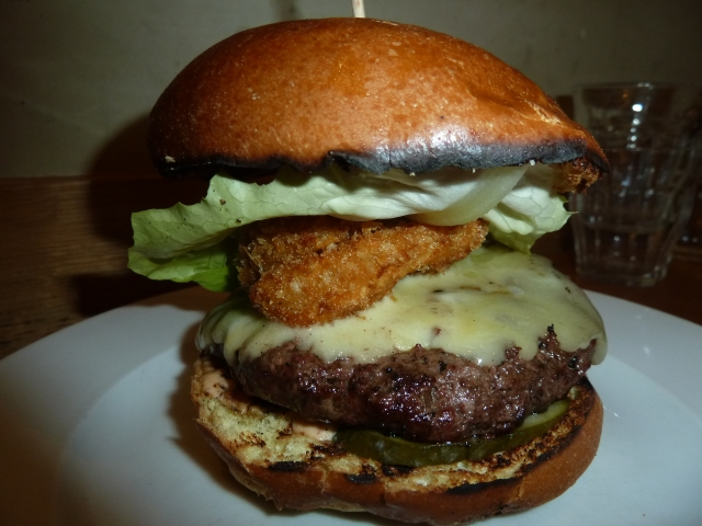 Gourmet Burger Kitchen's Taxidriver: Brioche bun, American cheese, crispy onion ring, cajun relish, dill pickle, salad & smoked chilli mayo