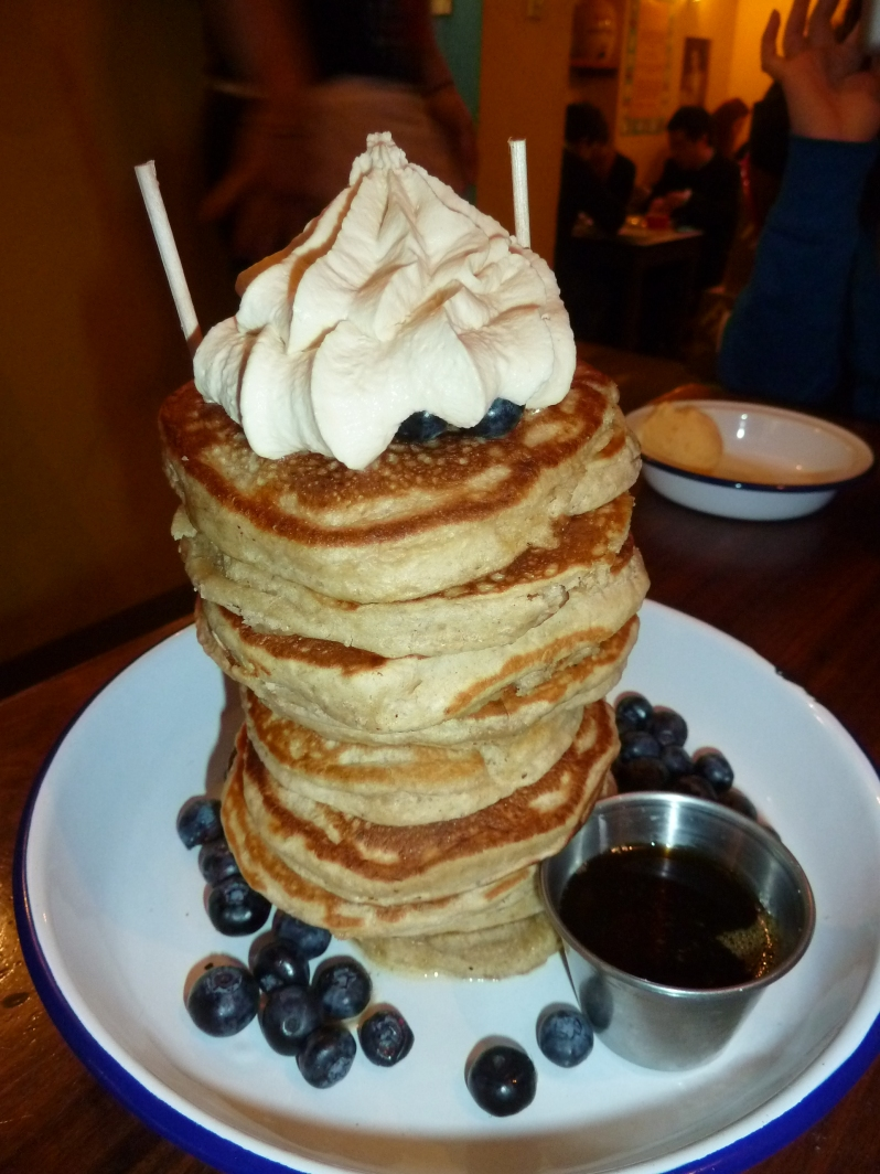 12 pancakes, whipped cream, blueberries and maple syrup