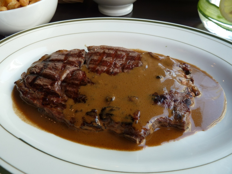 Don't judge by appearance: 300g of ribeye steak with green peppercorn sauce