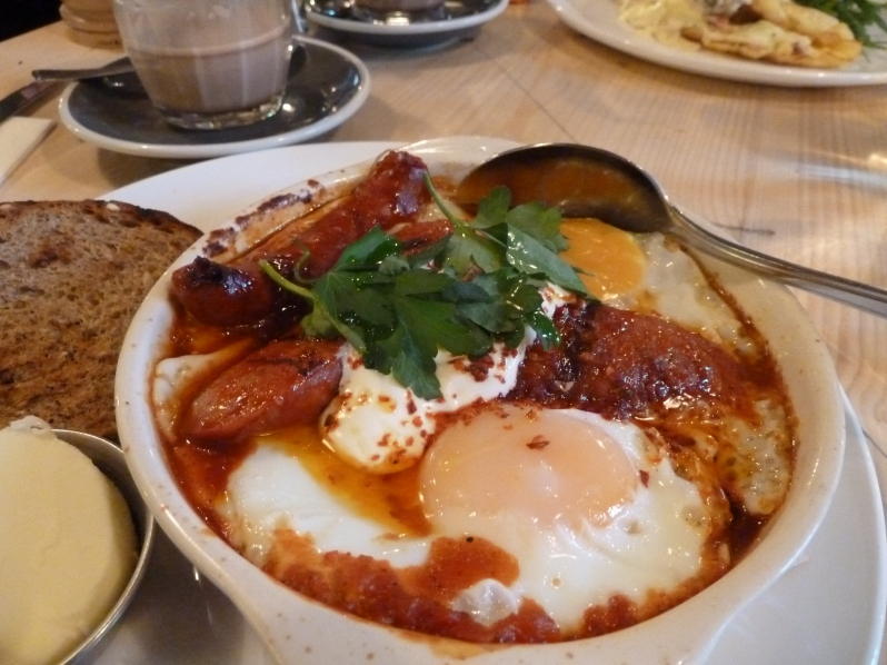 Baked eggs with chorizo, ragout, yoghurt and parsley
