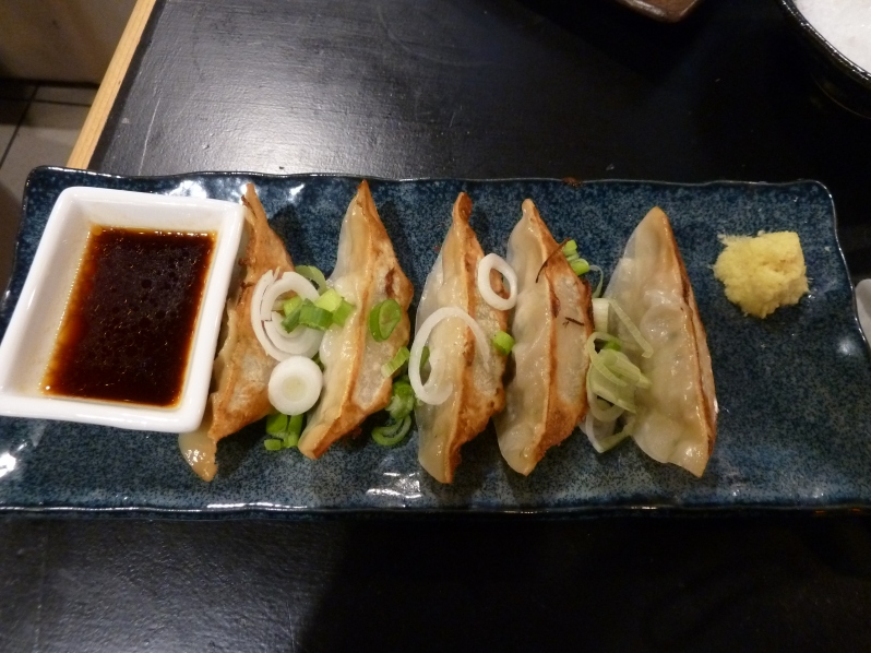 Pork gyoza with soy, ginger and spring onions