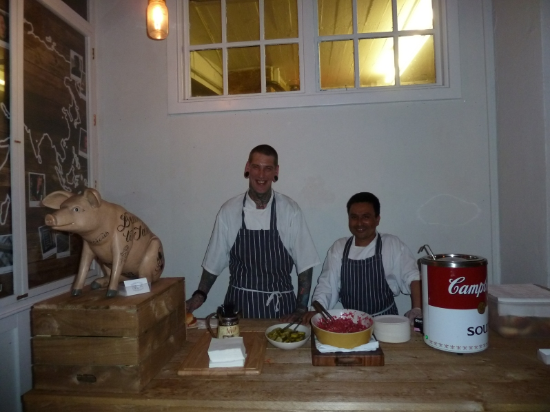 The boys ready to serve up delicious pulled pork...out of a giant Campbell's soup can!