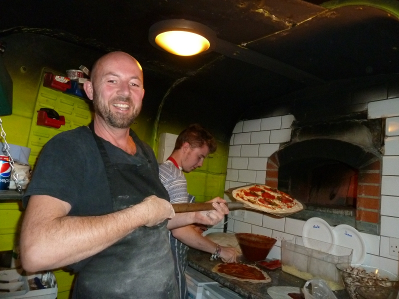 Hubertus cooking some pizza