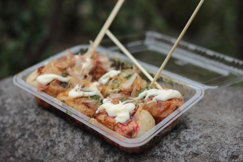 Takoyaki - octopus ball in a slightly sweet, slightly gooey batter, topped with mayonnaise, seaweed, fish flakes (dried bonito) and takoyaki sauce (brown, sweet and similar to Worcestershire sauce)