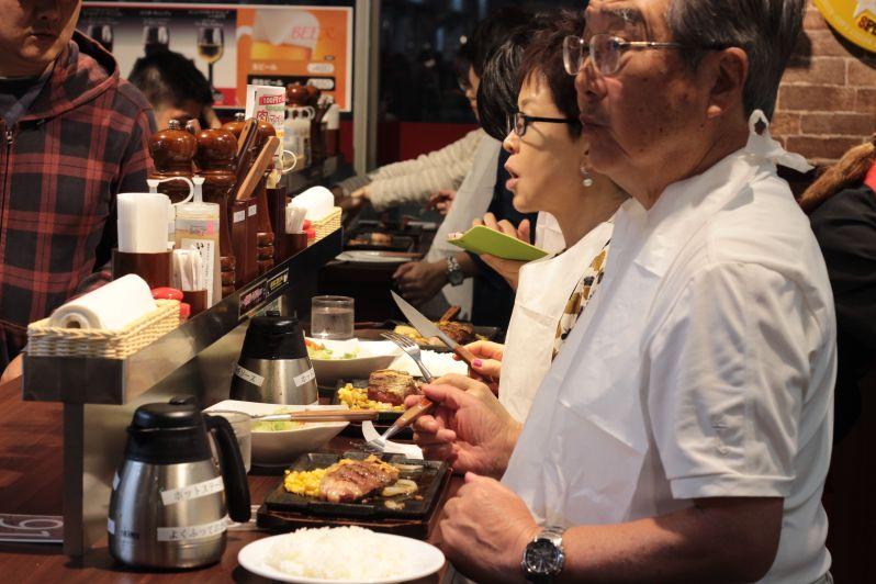 Customers enjoying their steaks