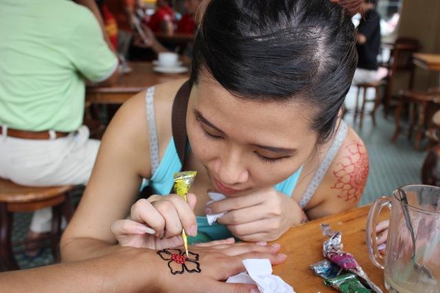 Shuet Li, drawing me some beautiful henna!